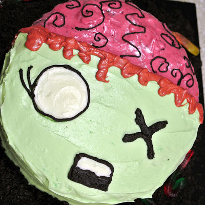 A Zombie Apocalypse Birthday Party (at which I don't dress up, but my unborn baby does)